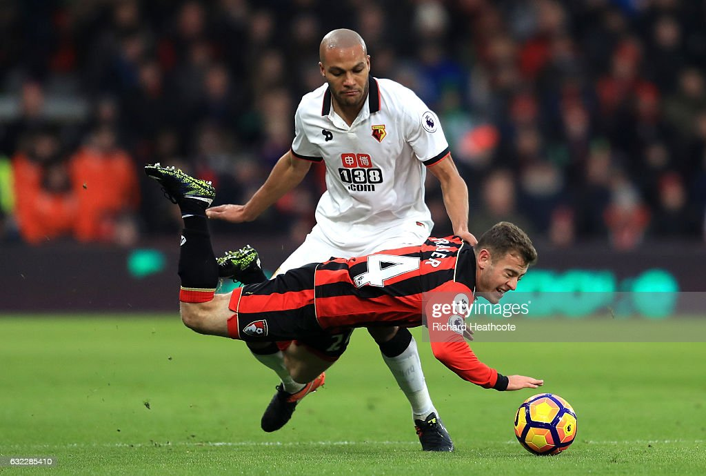 Younes Kaboul of Watford (L) fouls Ryan Fraser of AFC Bournemouth (R) during the Premier League match between AFC Bournemouth and Watford at Vitality Stadium on January 21, 2017 in Bournemouth, England.