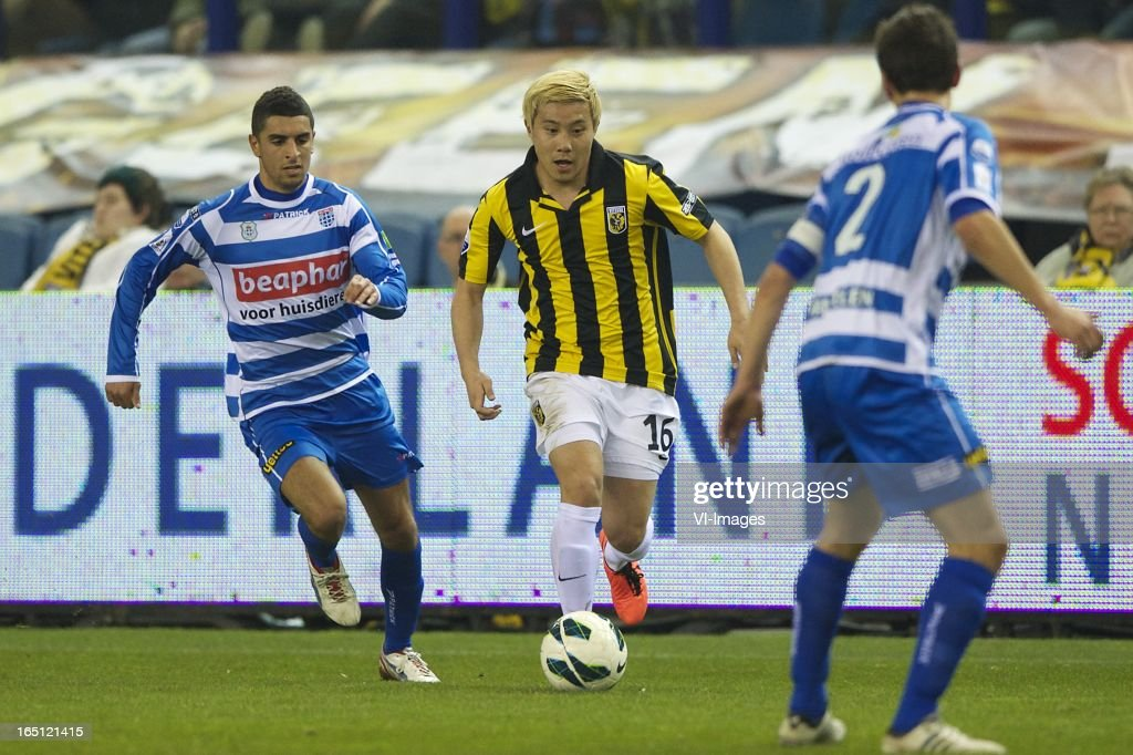 Youness Mokhtar of PEC Zwolle, Michihiro Yasuda of Vitesse, Bram van Polen of PEC Zwolle during the Dutch Eredivisie match between Vitesse Arnhem and PEC Zwolle at the Gelredome on march 31, 2013 in Arnhem, The Netherlands