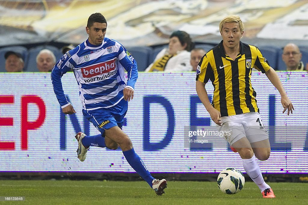 Youness Mokhtar of PEC Zwolle, Michihiro Yasuda of Vitesse during the Dutch Eredivisie match between Vitesse Arnhem and PEC Zwolle at the Gelredome on march 31, 2013 in Arnhem, The Netherlands