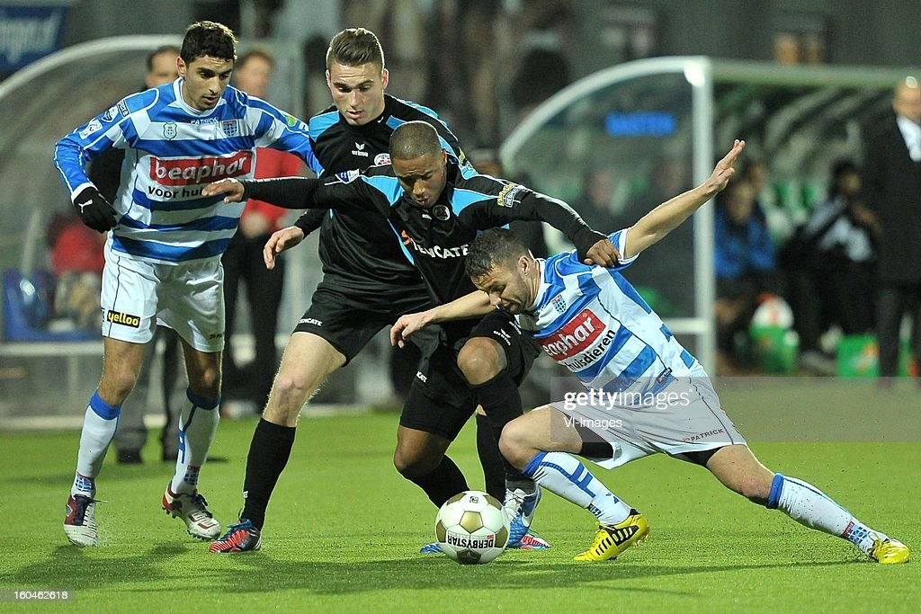 Youness Mokthar of PEC Zwolle, Bart Schenkeveld of Heracles Almelo, Lerin Duarte of Heracles Almelo, Rochdi Achenteh of PEC Zwolle during the Dutch Cup match between PEC Zwolle and Heracles Almelo at the IJsseldelta Stadium on january 30, 2013 in Zwolle, The Netherlands