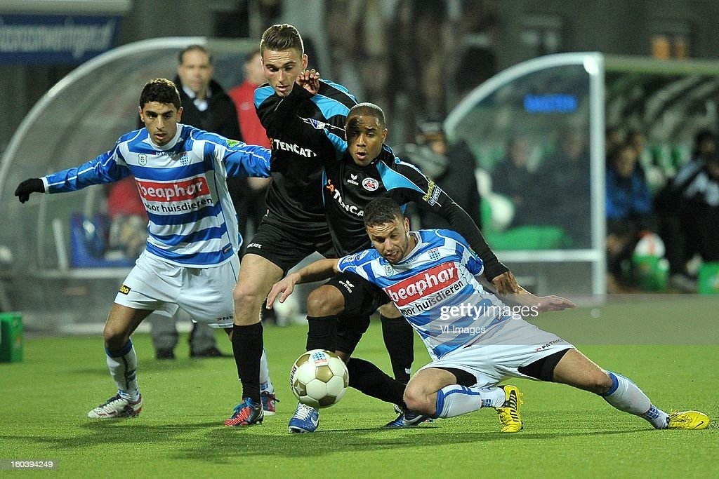 Youness Mokthar of PEC Zwolle, coach Art Langeler of PEC Zwolle, Bart Schenkeveld of Heracles Almelo, Lerin Duarte of Heracles Almelo, Rochdi Achenteh of PEC Zwolle during the Dutch Cup match between PEC Zwolle and Heracles Almelo at the IJsseldelta Stadium on january 30, 2013 in Zwolle, The Netherlands