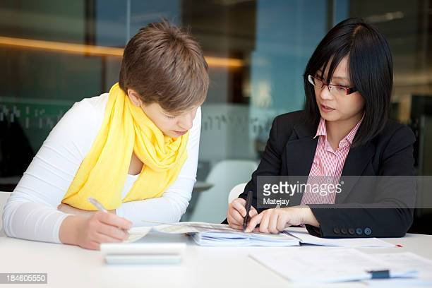 A young accountant with a glasses in a meeting in the office
