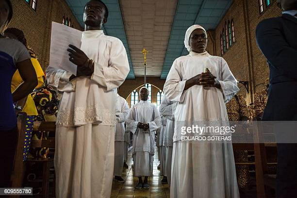 TOPSHOT Young acolytes take part in a Catholic mass in Kinshasa on September 21 2016 to mourn the victims of the violent clashes of the last few days...