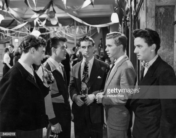 Young actor Ian Whittaker confronts James Kenney in the presence of the Cosh gang played by Stanley E Scane Sean Lynch and John Briggs in a scene...