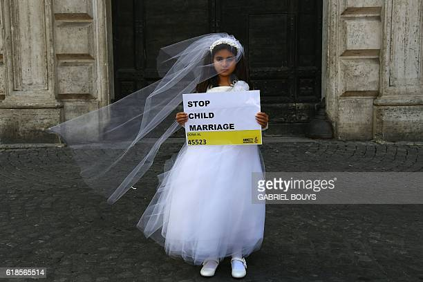 TOPSHOT A young actress plays the role of Giorgia forced to marry Paolo during a happening organised by Amnesty International to denounce child...