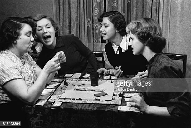 Young actress Veronica Hurst plays a board game with family members Hurst only 19 years old recently signed a seven year contract with Associated...