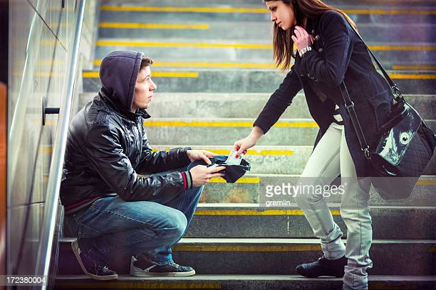 Young adult begging on the streets of Europe