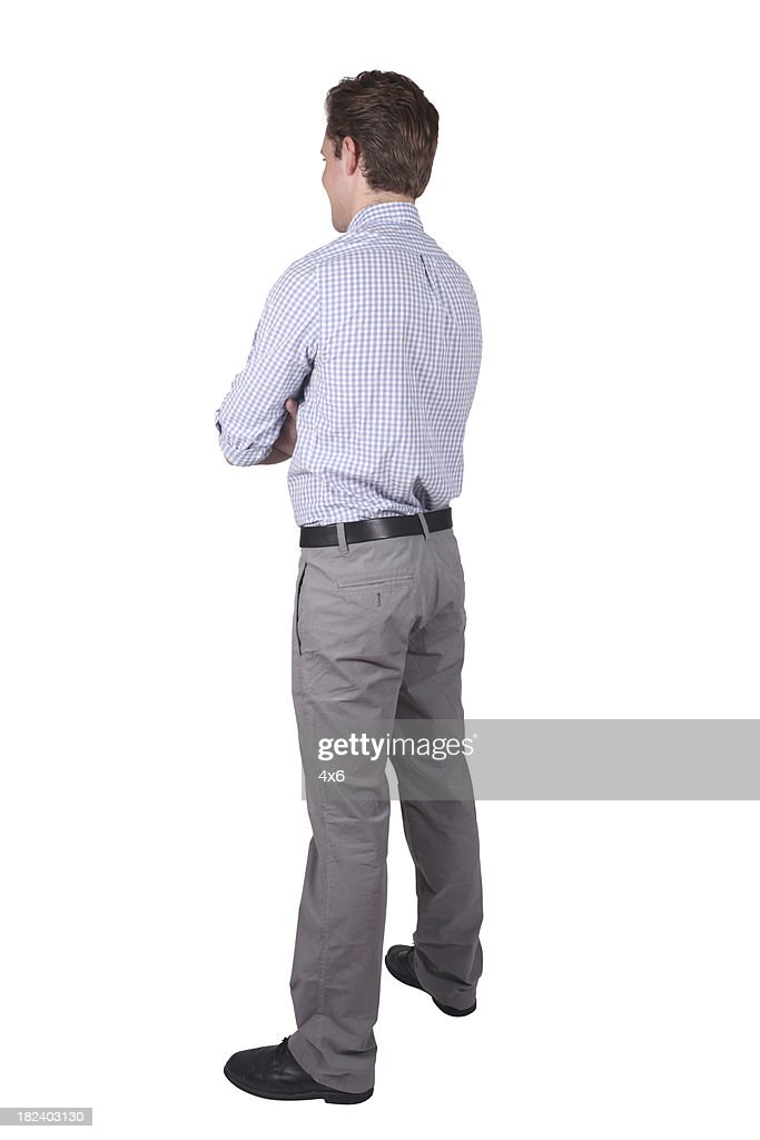 Young adult businessman facing away arms folded : Stock Photo