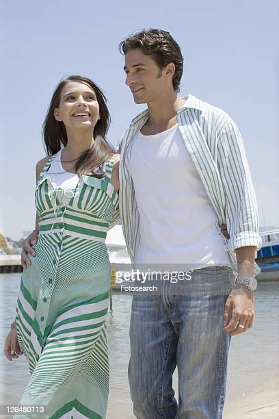 Young adult couple walking on beach, Low Angle View