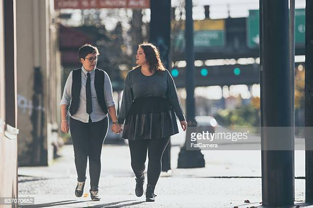 A young adult female couple is out on a walk together