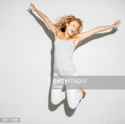 Young adult female jumping for joy
