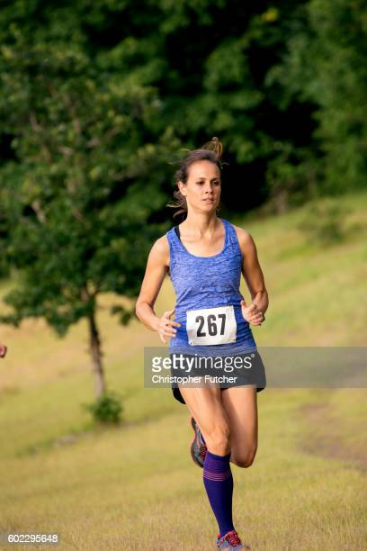 Young adult female trail running