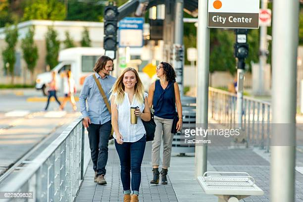 Young adult female working professional drinking coffee and walking