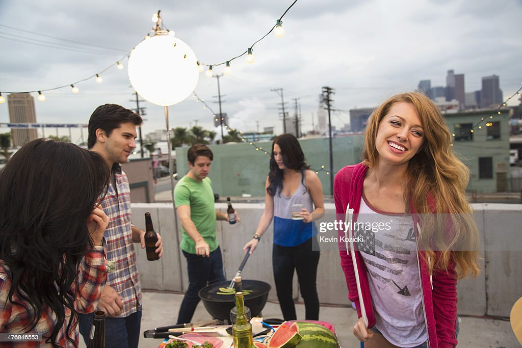 Young adult friends enjoying barbeque : Stock Photo