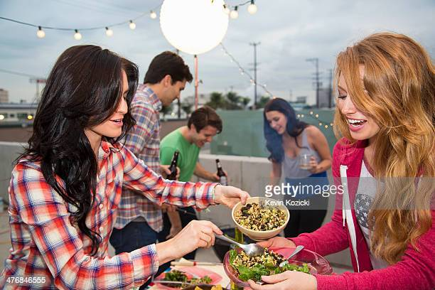 Young adult friends enjoying food at barbeque