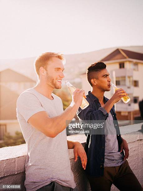 Young adult friends hanging out for a drink on rooftop