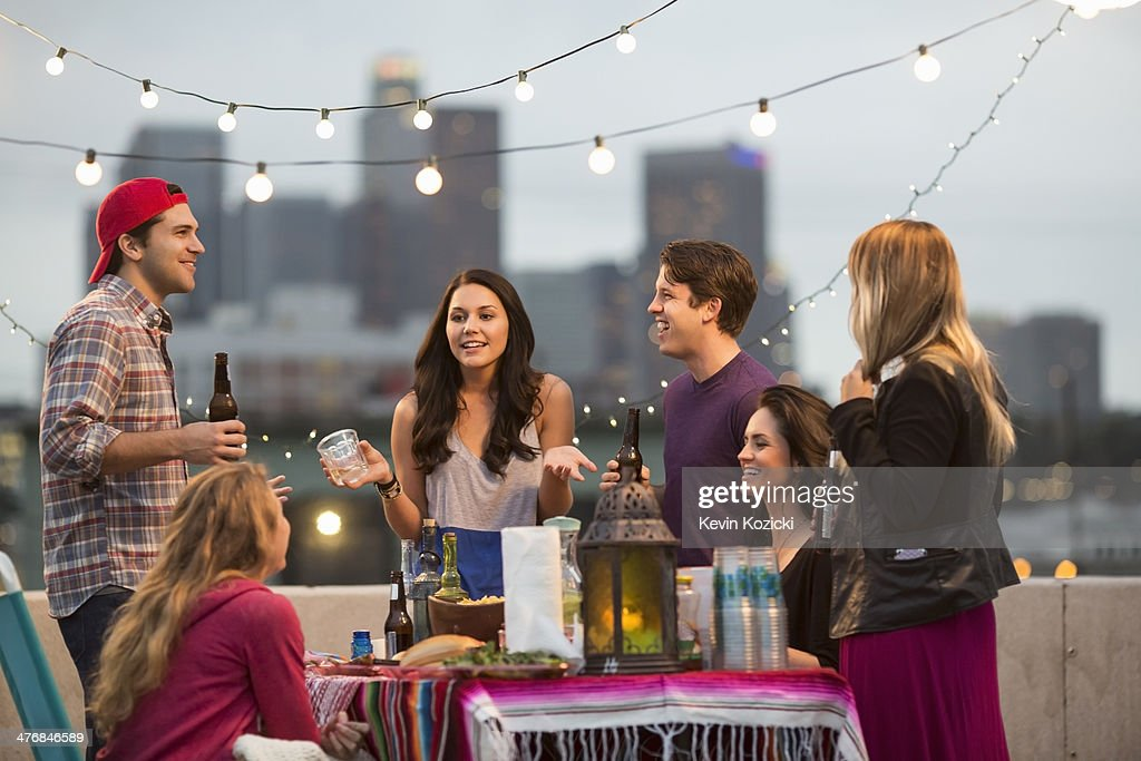 Young adult friends having fun at barbeque : Stock Photo