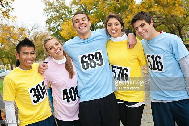 Young adult friends smiling at a charity race