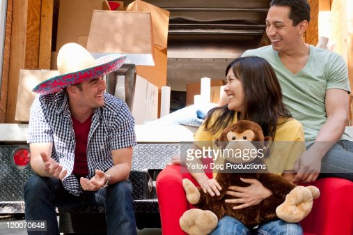 Young Adult Friends taking a break while moving : Stock Photo