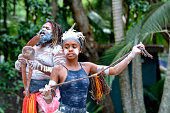 Young adult Indigenous Australian woman dancing in Queensland, Australia.