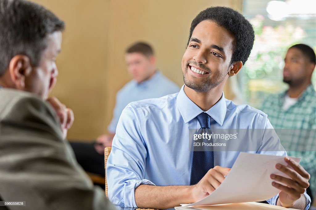 Young adult male smiling at a job interview