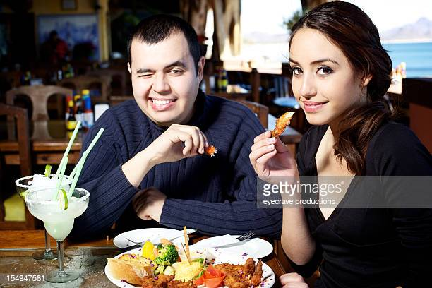 young adult Mexican couple dining