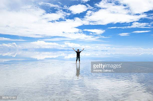 A young adult posing on the Uyuni Salar. Bolivia