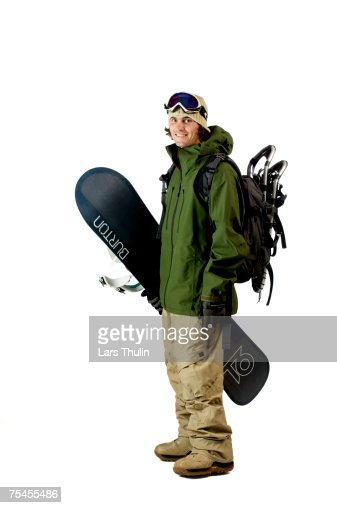 Young adult with snowboard.