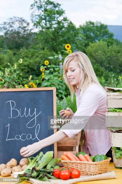 Young Adult Woman at Farmer's Market Vertical