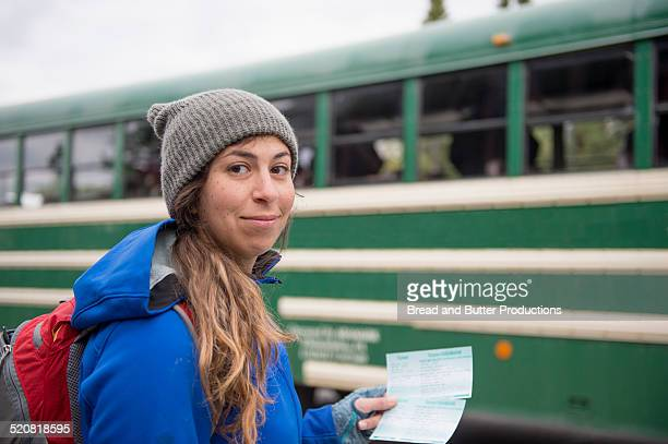 Young Adult Woman Holding Bus tickets, Denali Park