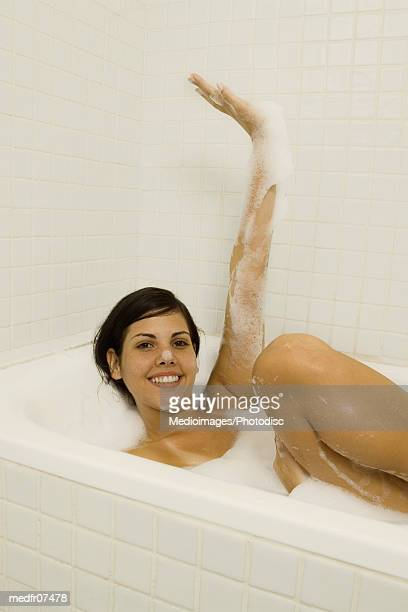 Young adult woman in bathtub