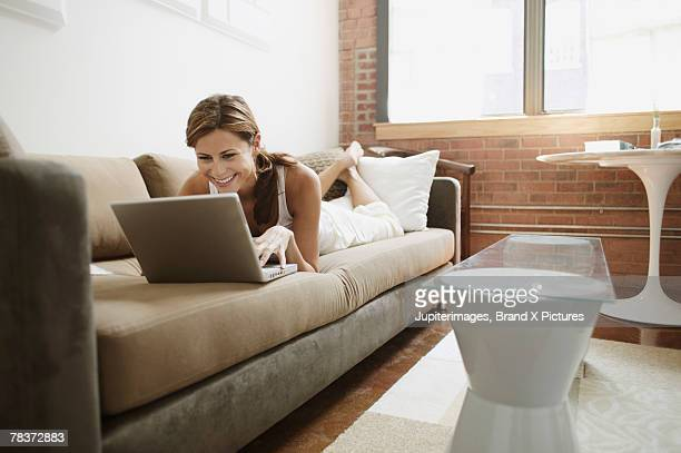 Young adult woman using laptop computer