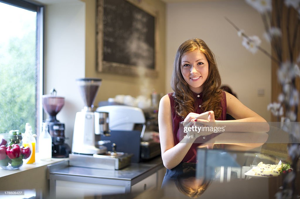 young adult working in cafe
