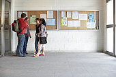 Young adults by notice boards