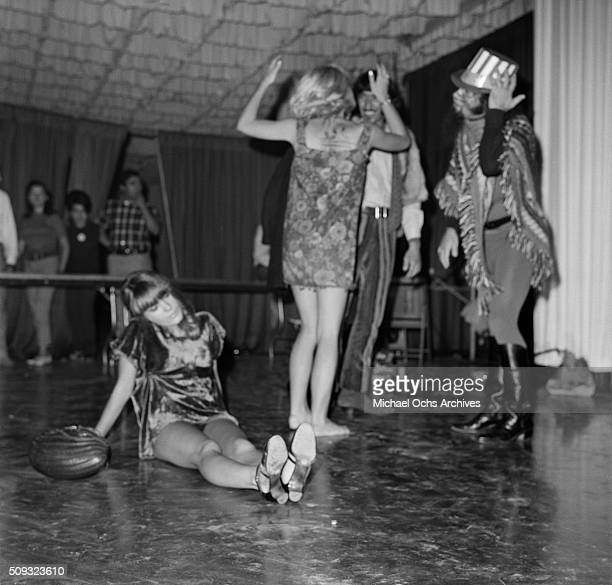 Young adults dance as Frank Zappa and The Mothers of Invention perform the concert ' Freak Out' at Whisky A Go Go in Los AngelesCalifornia 'n