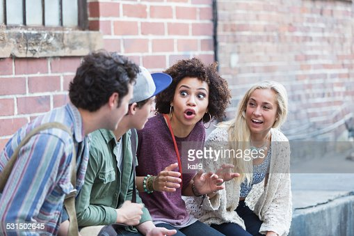 Young adults hanging out talking