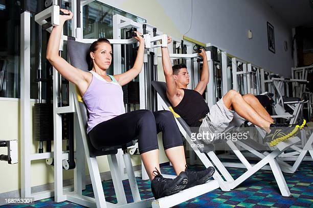 Young adults in a modern health/fitness club.