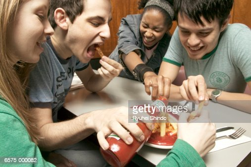 Young Adults in Diner : Stock Photo