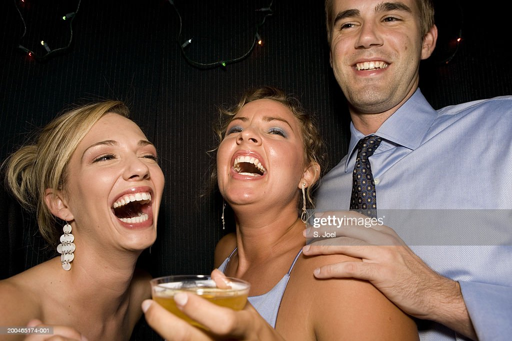 Young adults in formal attire holding champagne glasses : Stock Photo