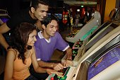Young adults in video arcade