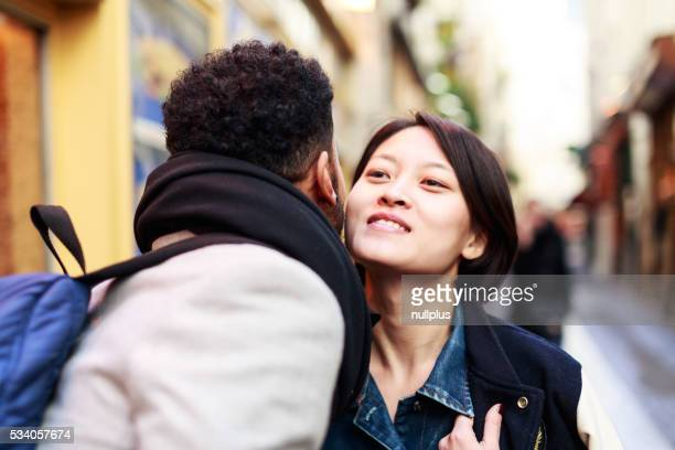 Young adults kissing in the streets of Paris