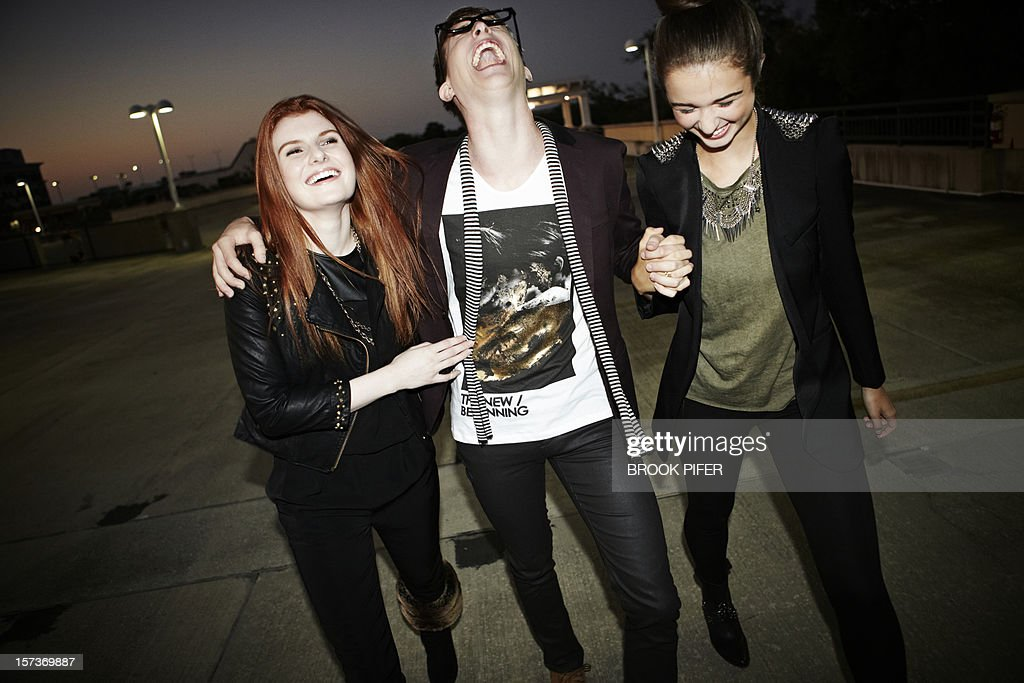 Young adults laughing together