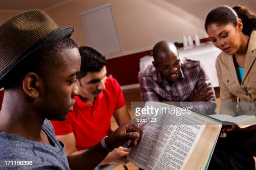 Young adults, multi-ethnic group in a Bible study at church.