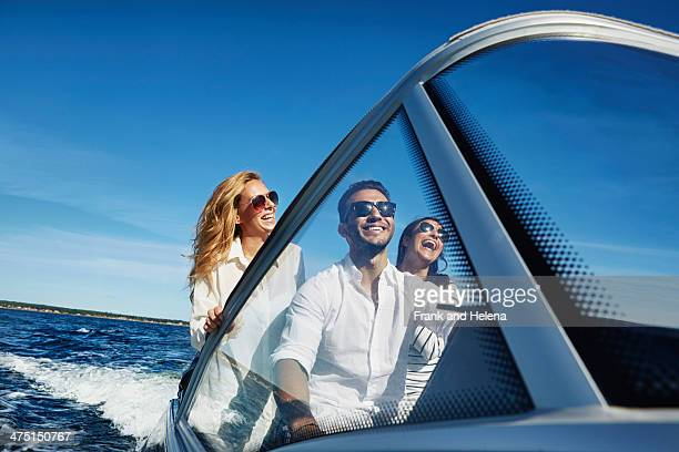 Young adults on boat, Gavle, Sweden