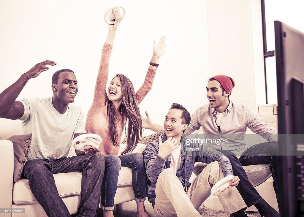 Young Adults Playing Video Games : Stock Photo