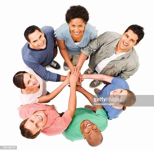 Junge Erwachsene Putting Ihre Hände zusammen-isoliert