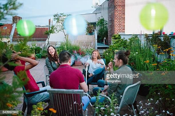 young adults, roof garden, talking, smoking Hookah