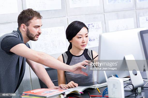 Young adults working in office