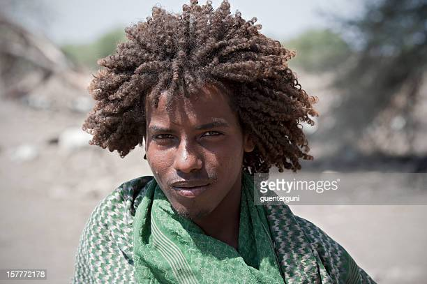 Young Afar man with typical hairstyle, Danakil Desert, Ethiopia - Ethiopian Hairstyle Stock Photos And Pictures Getty Images