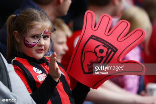 A young AFC Bournemouth fan looks on during the Premier League match between AFC Bournemouth and Stoke City at the Vitality Stadium on May 6 2017 in...